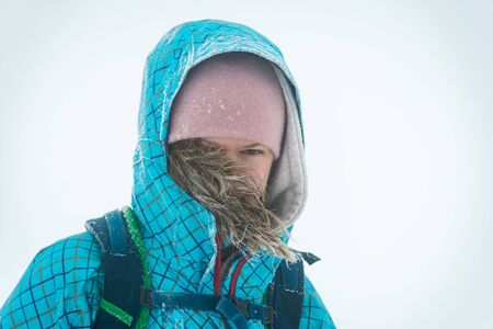 Woman portrait in the snow mountains