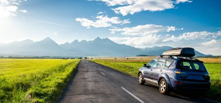 car for traveling with a mountain road. Slovakia Imagens