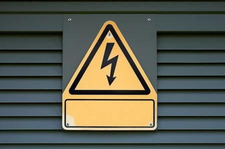 Sign on high electric voltage on a transformer box.