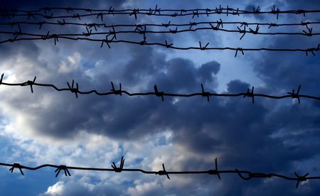 Barbed wire against the dark blue sky photo
