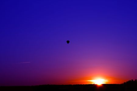 Sunset over the forest. Flying a balloon and aircraft. photo