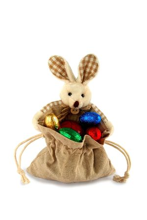 Easter bunny with bags full of gifts photo