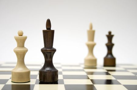 Chess queen and king - interracial marriage concept