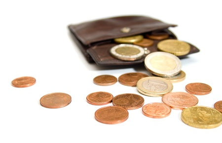 denominational: Euro coins spilling out of open leather wallet