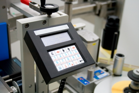 Medicine production in a pharmaceutical industry. Control panel labeling machine. Editorial