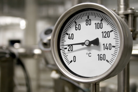 Circular industrial temperature meter photo