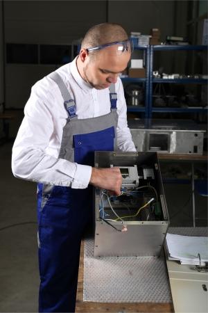 mechanician: workman in blue overalls