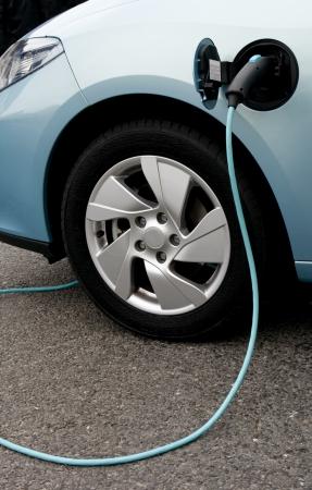 electro: Electric car gegen Geb�hr Punkt Lizenzfreie Bilder