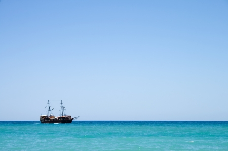 greece flag: Pirate ship with tourists at sea in Rethymnon, Crete, Greece