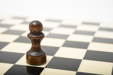 Black Pawn on a chess board Stock Photo