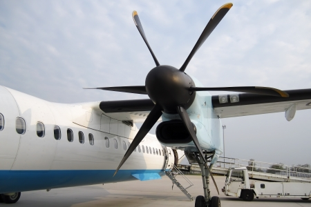 Side propeller of the plane with airplane at the airport Stock Photo