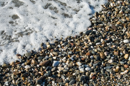Close up sea wave and pebble Stock Photo