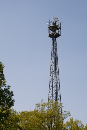 Telecommunications tower  Mobile phone base station Stock Photo