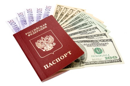 Russian international passport and money on white background