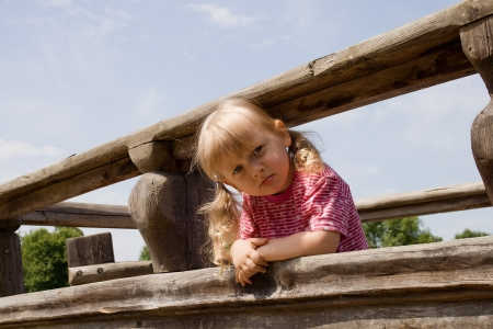 Angry little girl on the playground Stock Photo