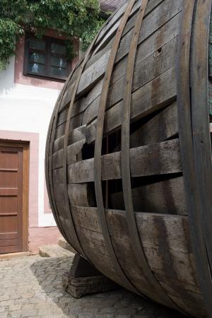 very old large wine barrel, oval shaped,side view photo