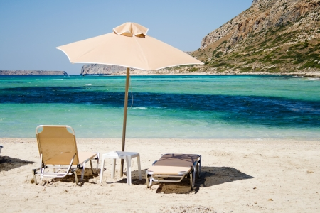sunbed: Beach chairs with umbrella on the sand beach Stock Photo