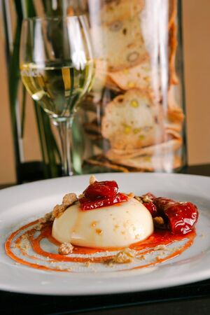 cotta: Rhubarb panna cotta with white wine in background