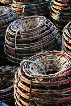 Stack of craypots on a fishing boat photo