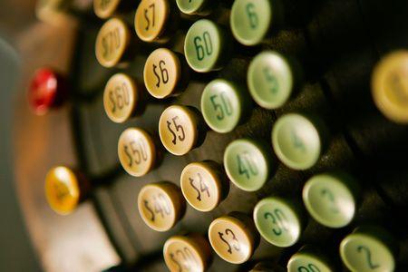 Close up of keys on an old cash register photo