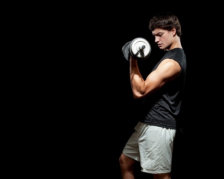 man lifting weights: Young Man Exercising