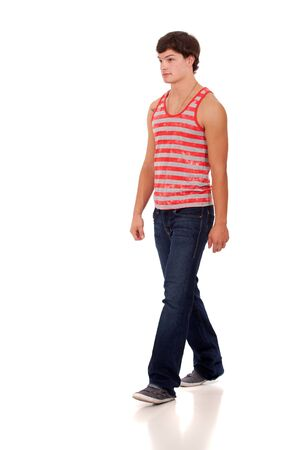 Young man in red and white striped shirt and jeans. Stock Photo