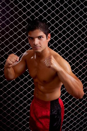 Mixed martial artist posed in front of chain link Stock Photo - 7908459