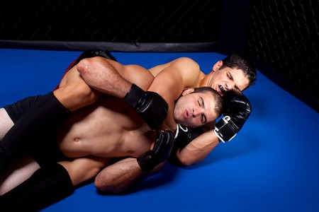 choke: Mixed martial artists fighting - ground fighting