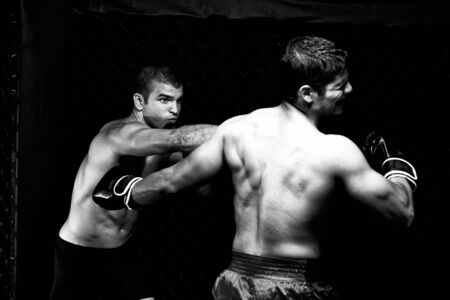 mixed martial arts: MMA - Mixed martial artists fighting - punching Stock Photo
