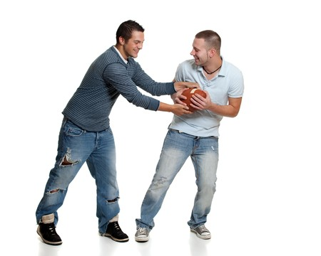 bros: Two men with football
