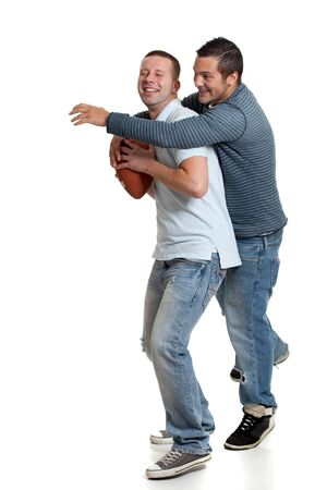 horseplay: Two men with football