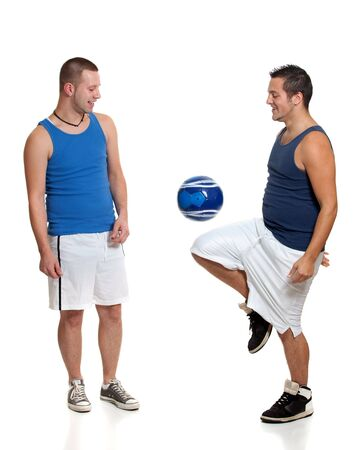 horseplay: Two men with soccer ball Stock Photo