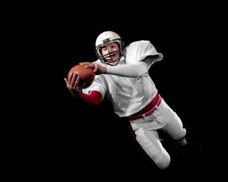 gevangen: American football speler. Stockfoto