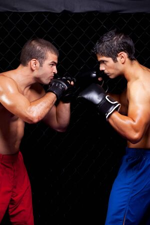 opponents: Mixed martial artists before a fight Stock Photo