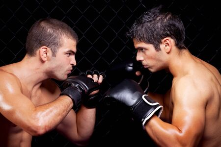 mixed martial arts: Mixed martial artists before a fight Stock Photo