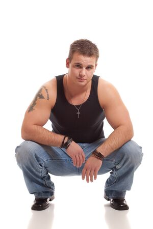Casual young man in black undershirt and jeans. photo