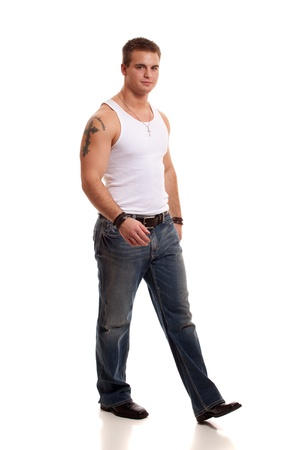 Casual young man in white undershirt and jeans. Stock fotó