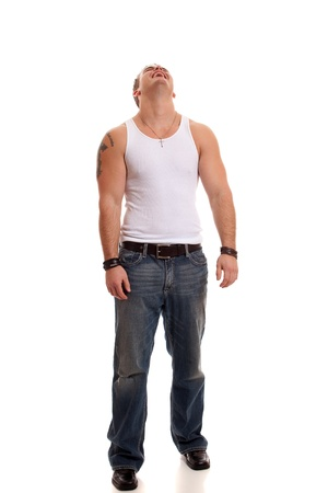undershirt: Casual young man in white undershirt and jeans. Stock Photo