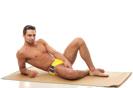 beach mat: Man in Swimwear Stock Photo