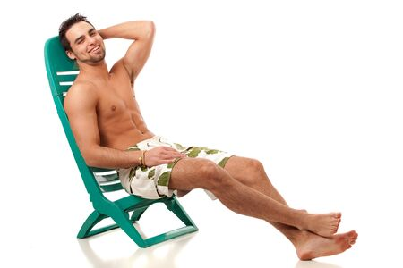 reclining chair: Man in Swimwear Stock Photo