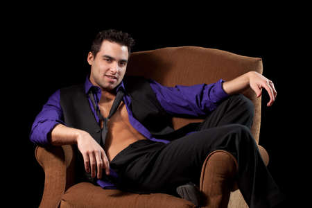 shirt unbuttoned: Man in Chair