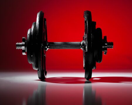 weightlifting equipment: Dumbbell on Red