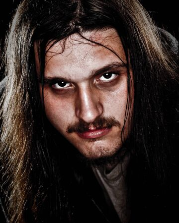 rough: Man With Long Hair Stock Photo