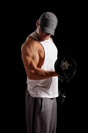 levantar peso: El hombre levantando pesas