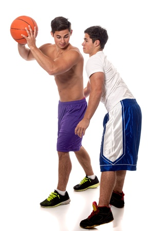 opponents: Male basketball players. Studio shot over white.