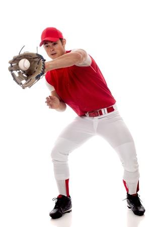 catching: Baseball player fielding. Studio shot over white.