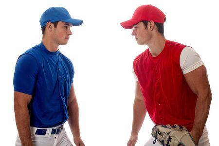 opponents: Two baseball opponents. Studio shot over white. Stock Photo