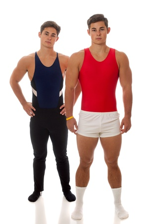 confrontational: Young adult male gymnasts. Studio shot over white. Stock Photo