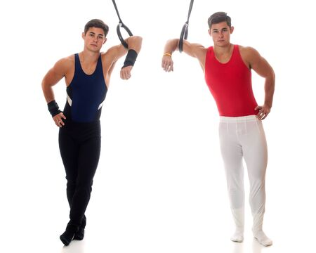 Young adult male gymnasts. Studio shot over white. photo