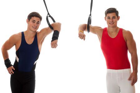 boy gymnast: Young adult male gymnasts. Studio shot over white. Stock Photo
